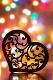 Silhouette of tracery heart with garland lights on background in Stock Photography