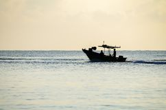 Silhouette traditional fisherman going to catch fish at early morning with his boat Stock Image