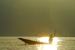 Silhouette of traditional fishermans in Inle Lake,Myanmar. Royalty Free Stock Images