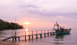Silhouette of traditional fishing boat at sunrise Stock Photography