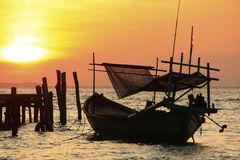 Silhouette of traditional fishing boat at sunrise, Koh Rong isla Stock Photo