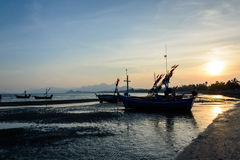 Silhouette of Traditional wooden fishing boats on the beach Royalty Free Stock Photo