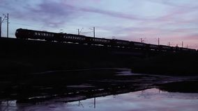 Silhouette Of Train Crossing Bridge. Trans-Siberian Railway, Full HD Resolution 1920x1080 Video Frame Rate 29.97 Length 0:22 stock video footage
