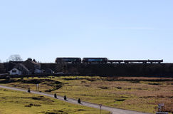 Silhouette of trains on embankment at Ribblehead Stock Photo