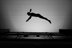 Silhouette trampoline girl Stock Images
