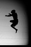 Silhouette trampoline jumper Royalty Free Stock Photography
