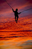 Silhouette trampolining boy gorgeous sunset Royalty Free Stock Images