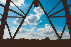 Silhouette of transmission tower. Steel transmission tower silhouetted against blue skies and clouds stock photography