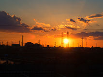 Silhouette of the transmission tower and sunset. Clouds royalty free stock photography