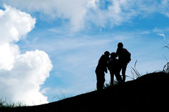 Silhouette travel family on mountain and Cloud blue sky Stock Photography