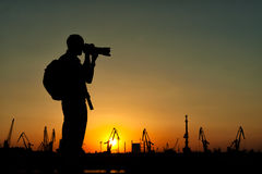 Silhouette of Travel Photographer Stock Images