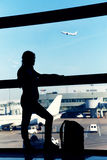Silhouette of a traveler at the airport Stock Photos
