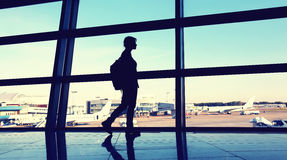 Silhouette of a traveler at the airport Royalty Free Stock Images
