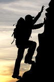 Silhouette of a traveler tourist mountaineer Royalty Free Stock Photos