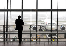 Silhouette of a traveler waiting for a plane. Stock Photo