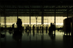 Silhouette of travelers at the airport Stock Photography