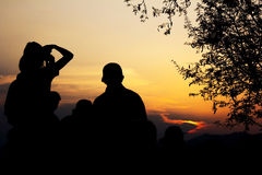 Silhouette of travelers with camera during sunset Royalty Free Stock Photo
