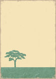 Silhouette of tree on grunge old paper Royalty Free Stock Image