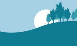 Silhouette of tree on hill Royalty Free Stock Images