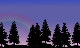 Silhouette of tree lined with rainbow landscape Stock Images