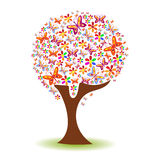 Silhouette of a tree with a pattern of butterflies and flowers Stock Image