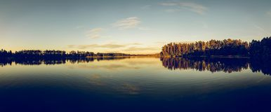 Silhouette of Trees Beside Body of Water Under Clear Blue Sky Royalty Free Stock Images