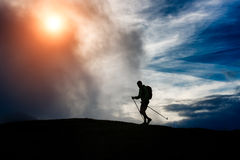 Silhouette trekking Stock Photos