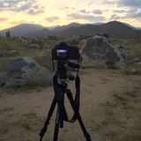Silhouette tripod and camera. on the Mountain and solar Stock Photography