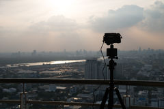 Silhouette tripod and camera. Taking picture of city Stock Photography