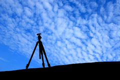 Silhouette of tripod under the blue sky Royalty Free Stock Photography