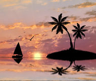 Silhouette of a tropical island with palm trees and a sailboat Royalty Free Stock Photo