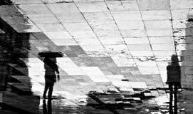 Silhouette trouble d'ombre de réflexion de deux personnes Photo stock