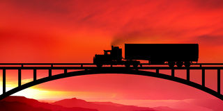 Silhouette of a truck on a bridge Stock Photos