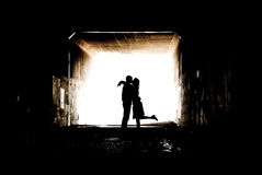 Silhouette in a Tunnel. Young couple holding hands in a tunnel Royalty Free Stock Photo