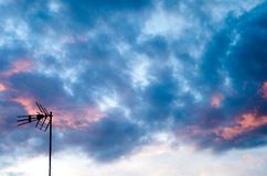 Silhouette of a tv antenna with the colorful sky on the backround royalty free stock photography