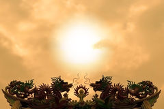 Silhouette of twin dragon at sunset. Silhouette of twin dragon on the roof at sunset royalty free stock photography
