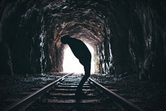 Silhouette of twisting man in abandoned railway tunnel Stock Image