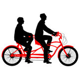 Silhouette of two athletes on tandem bicycle. Royalty Free Stock Images