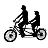 Silhouette of two athletes on tandem bicycle on white background.  Royalty Free Stock Photo