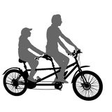 Silhouette of two athletes on tandem bicycle on white background.  Stock Image