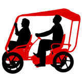 Silhouette of two athletes on tandem bicycle on white background.  Royalty Free Stock Images