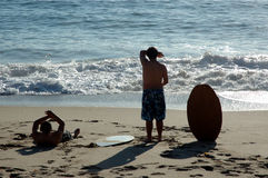 Silhouette of two body borders. Two teens at the beach stock photo