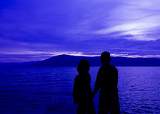 Silhouette two boy  in front of Lake Stock Photography