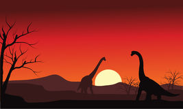 Silhouette of two brachiosaurus at sunset Stock Photo