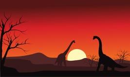 Silhouette of two brachiosaurus at sunset Stock Photo