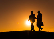 Silhouette of Two Businessman on the Hill Stock Images