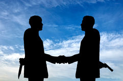 Silhouette of two businessmen shaking hands Royalty Free Stock Photography