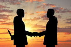 Silhouette of two businessmen shaking hands Royalty Free Stock Image