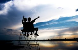 Silhouette of Two Children Looking at Body of Water Royalty Free Stock Photo