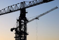 Silhouette of the two cranes Royalty Free Stock Photos